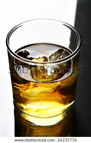 Glass of whisky with ice close up
