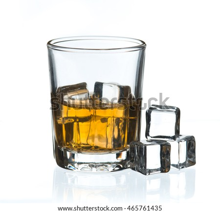Glass of whisky with ice on a white