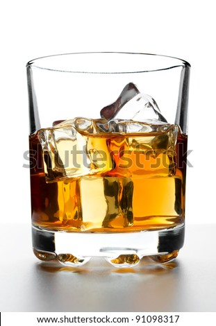 Glass of whisky with ice on a white backdrop