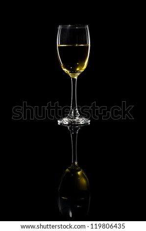 Glass of White Wine against Black Background - stock photo