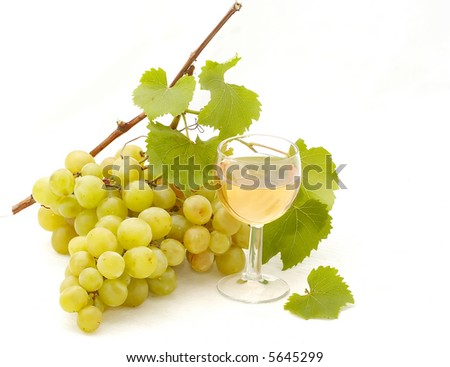 Glass of white wine and grape isolated on white