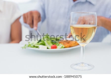 Glass of white wine on a table outside on a balcony