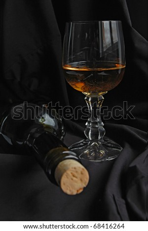 Glass of white wine on the black background
