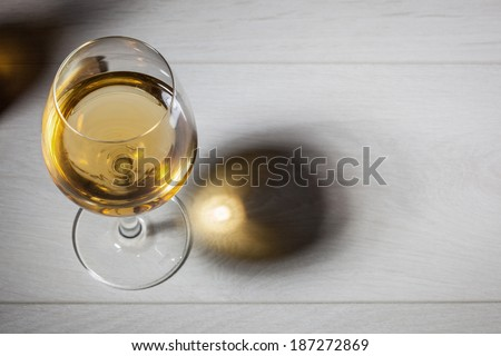 Glass of white wine on wooden table. Top view - stock photo