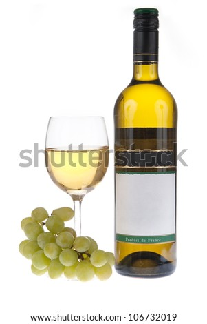 Glass of white wine with a bottle and grapes