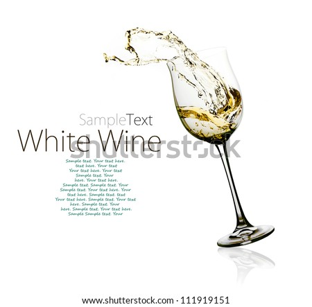 Glass of white wine with splashes on a w - stock photo