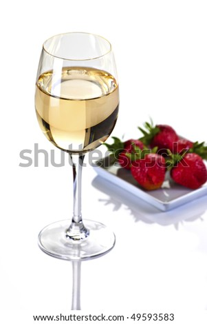 Glass of White Wine With Strawberries on a Plate on a White Background - stock photo