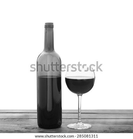 Glass of wine and bottle on wooden background black and white. Flat mock up for design. - stock photo