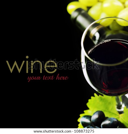 Glass of  wine and grape on black background  (easy removable sample text) - stock photo