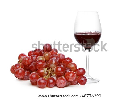 Glass of wine and grapes on a white background - stock photo