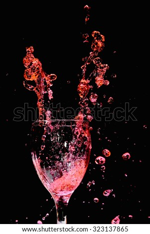 Glass of wine and red wine - stock photo