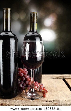 glass of wine and two bottles