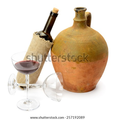 glass of wine, bottle and amphora isolated on white background - stock photo