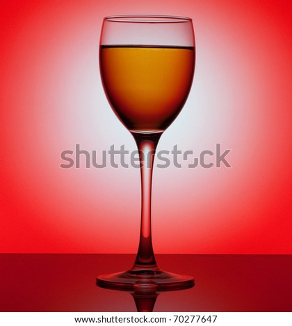 Glass of wine isolated over circle white background