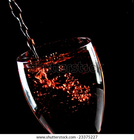 Glass of wine on a black background - stock photo