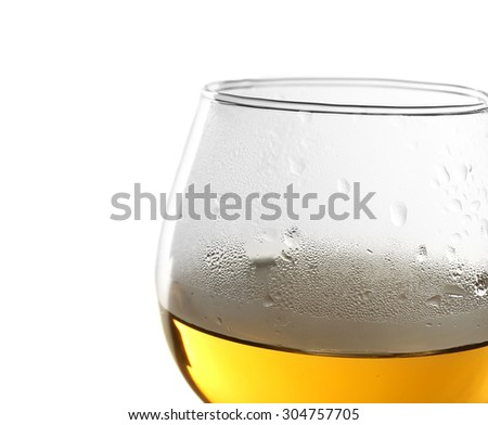 Glass of wine on light background