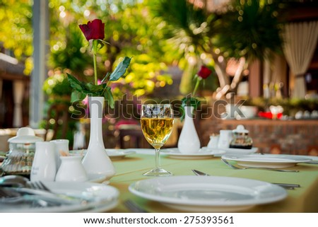 Glass of wine on served table. Restaurant - stock photo