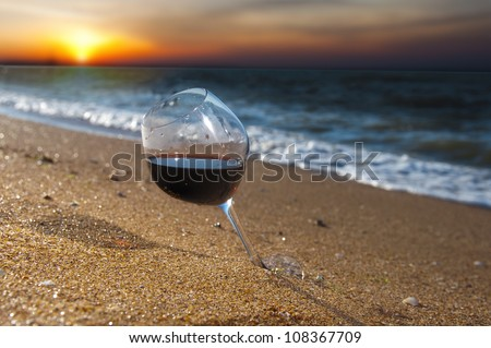 glass of wine on sunset - stock photo