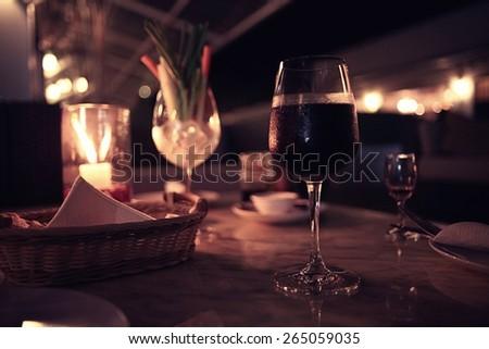 glass of wine restaurant interior serving dinner - stock photo
