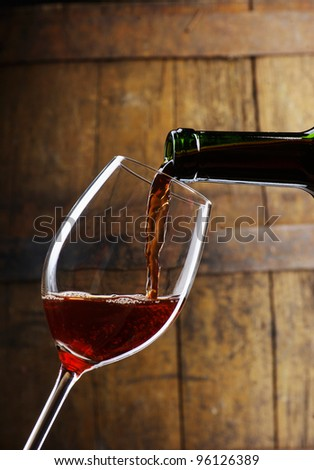 glass of wine  with barrel - stock photo