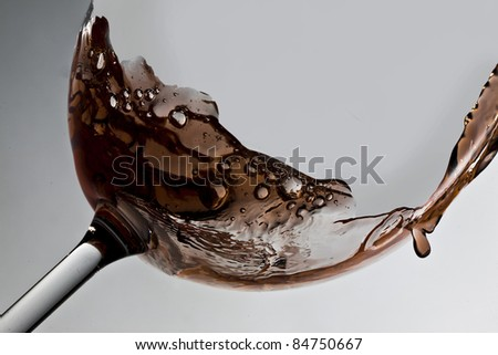 Glass of wine with drops - stock photo