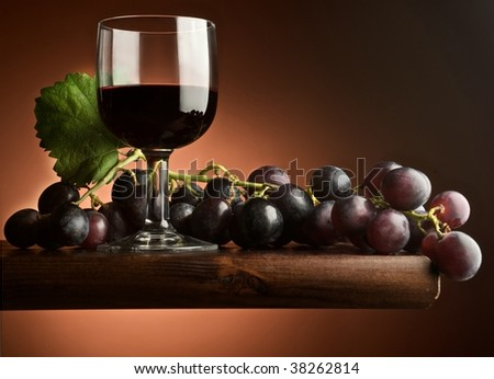 glass of wine with grape