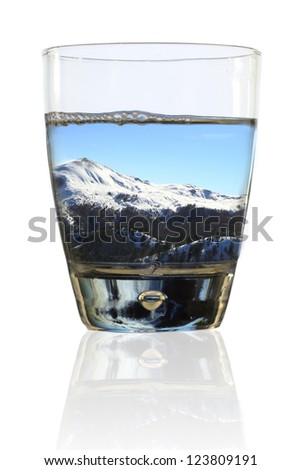 Glass of winter. Wintry landscape in a glass of water - stock photo