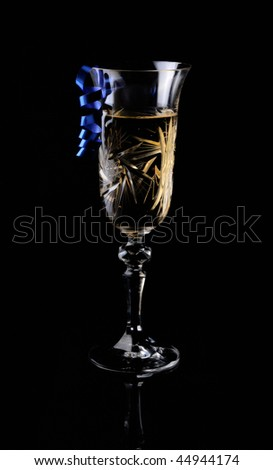 Glass of xmas champagne on a black background - stock photo