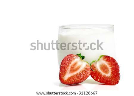 Glass of yoghurt, with fresh strawberries - stock photo