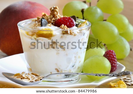 glass of yogurt with muesli and fruit - stock photo