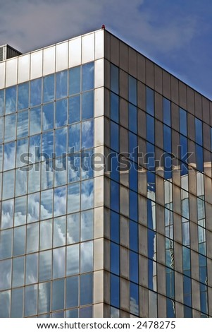 Glass office building reflecting
