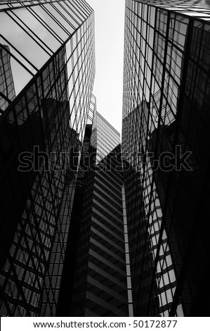 Glass office skyscrapers in black and white. - stock photo