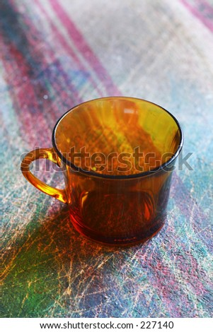 Glass on a colorfull table - stock photo