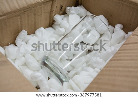 Glass on collision absorbing materials - stock photo