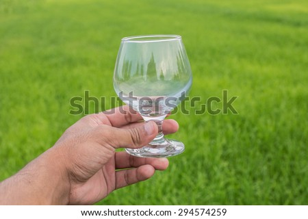 glass on the green background - stock photo