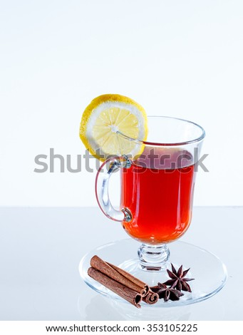 Glass  on the table. Wine glasses with tea and lemon and spices. Wine - stock photo