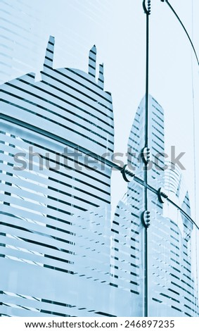 Glass panels on a modern building with details of the reinforcing structures - stock photo