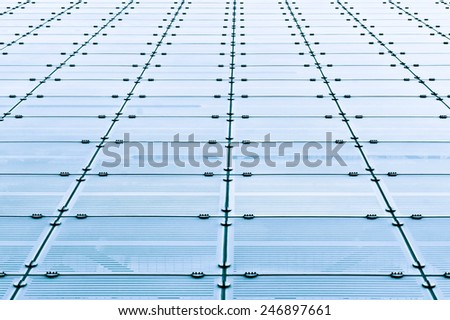 Glass panels on the outside of a modern building - stock photo