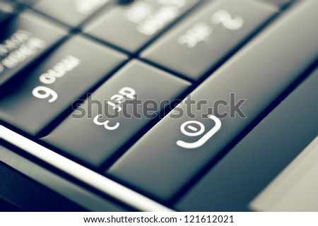Glass phone button close up in retro style - stock photo