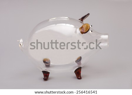 Glass Piggy bank over gray background - stock photo
