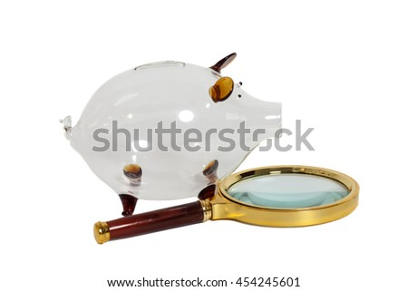 Glass Piggy bank with magnifying glass isolated on white - stock photo