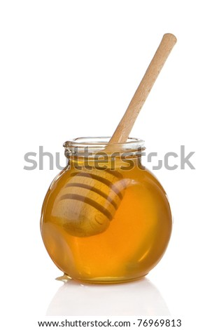 glass pot full of honey and stick isolated on white background - stock photo