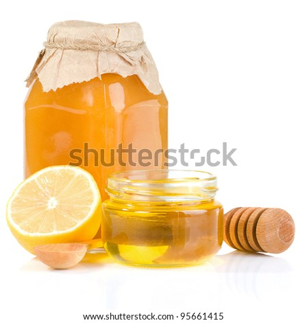 glass pot of honey and citrus isolated on white background