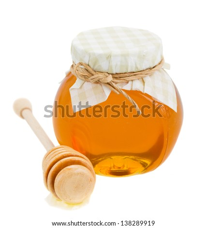 glass pot  with floral honey and stick isolated on white background - stock photo