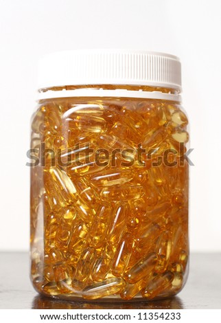Glass pot with gold shiny boluses - stock photo