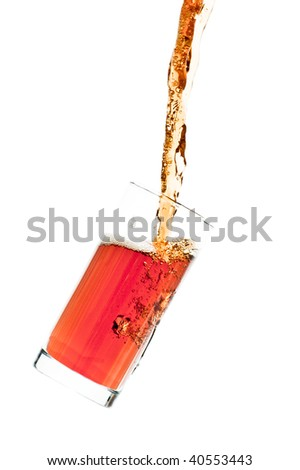 Glass pouring with a splashing cola - isolated on white - stock photo