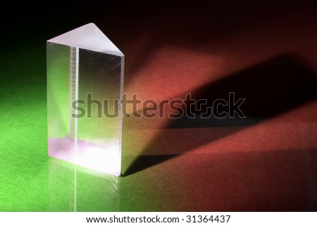 Glass Prism on Green and Red Background - stock photo