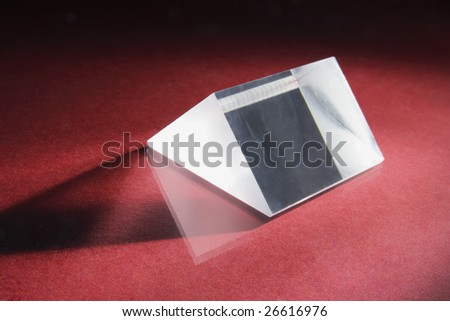 Glass Prism on Red Background - stock photo