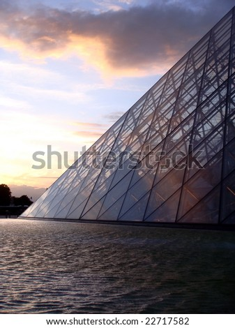 Glass Pyramid at the Louvre in Paris, France - stock photo