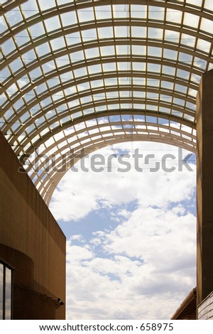 Glass roof at the Denver theatre district's outside galleria area looking toward the Rocky Mountains.